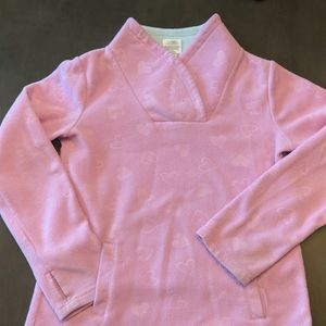 Pink pullover with hearts.